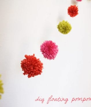 diy pompom garland on the sweetest occasion thumbnail