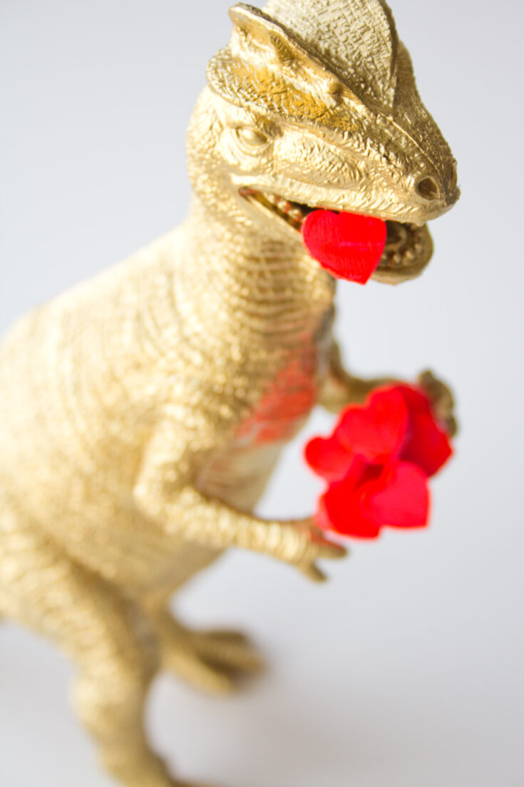 dinosaur valentine with hearts in mouth