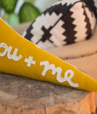 Make and Give // DIY You + Me Pennant Pillows thumbnail