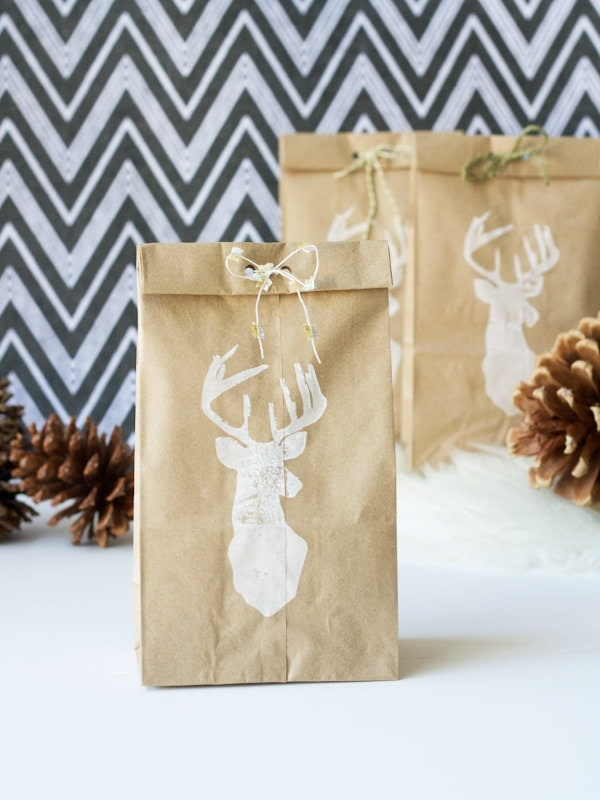stamped brown paper bags using stags head stamp and white ink, tied with twine at top