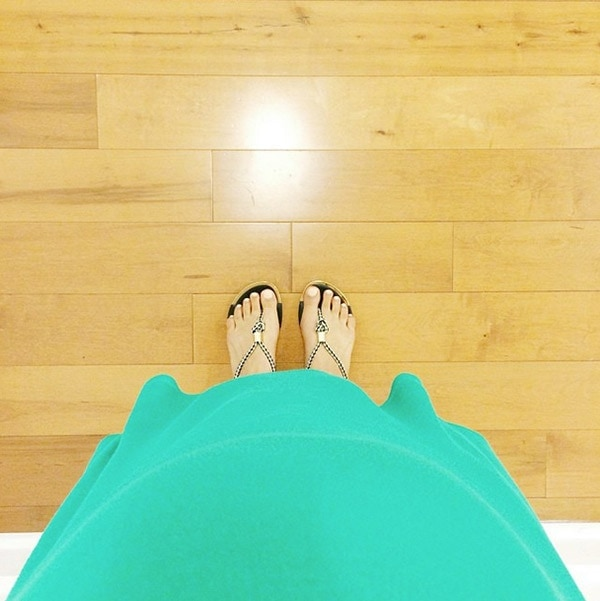 Pregnant tummy with feet