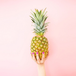 pineapple on a pink wall