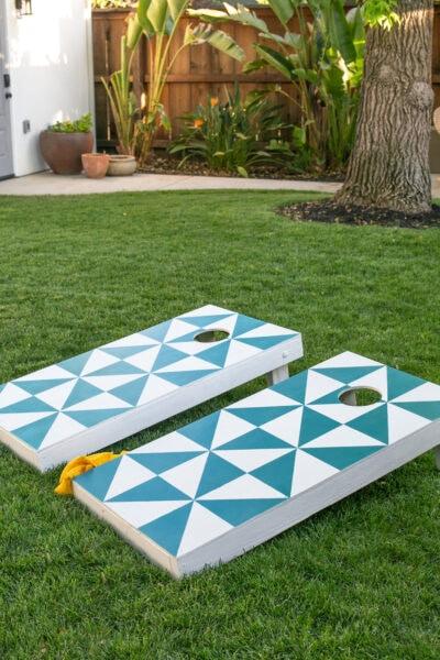 cornhole board on grass