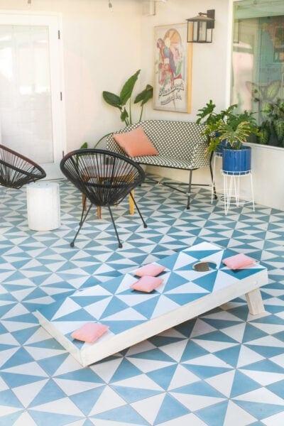 cornhole board on a patio