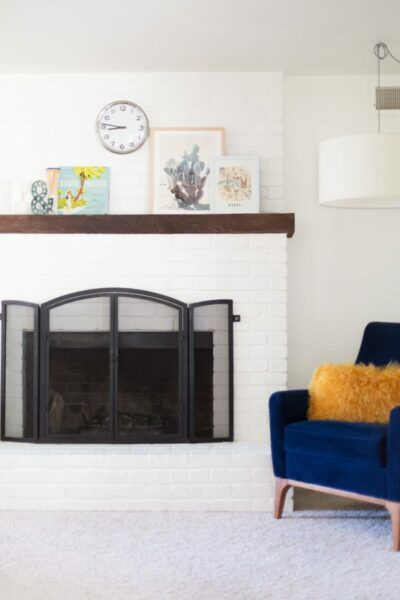 White paint on a brick fireplace in living room