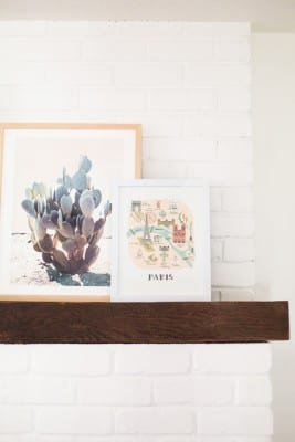 Painted brick fireplace with art