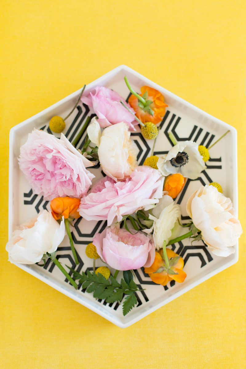 Floral arrangement in a hexagonal dish