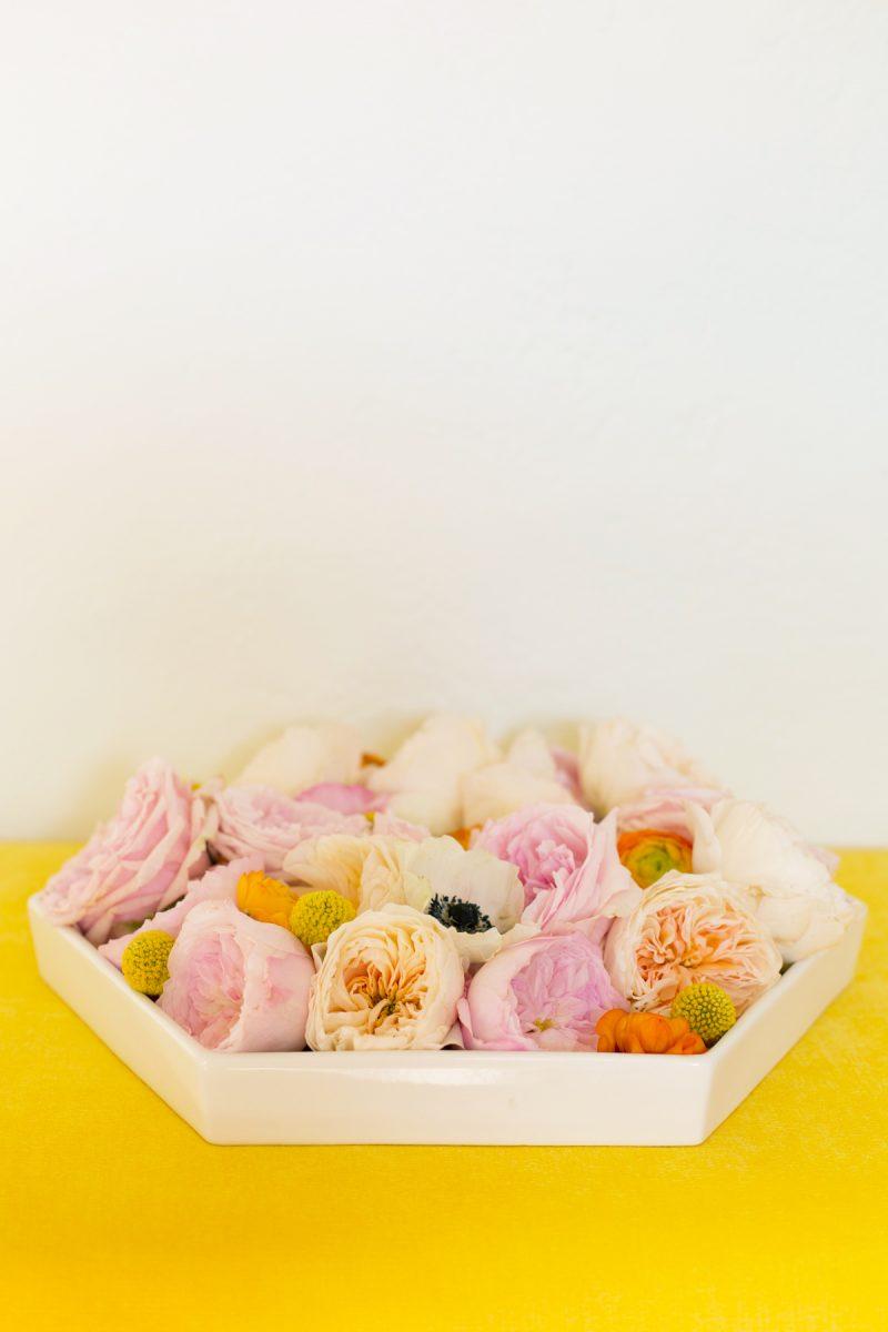 Floral arrangement in a hexagonal dish