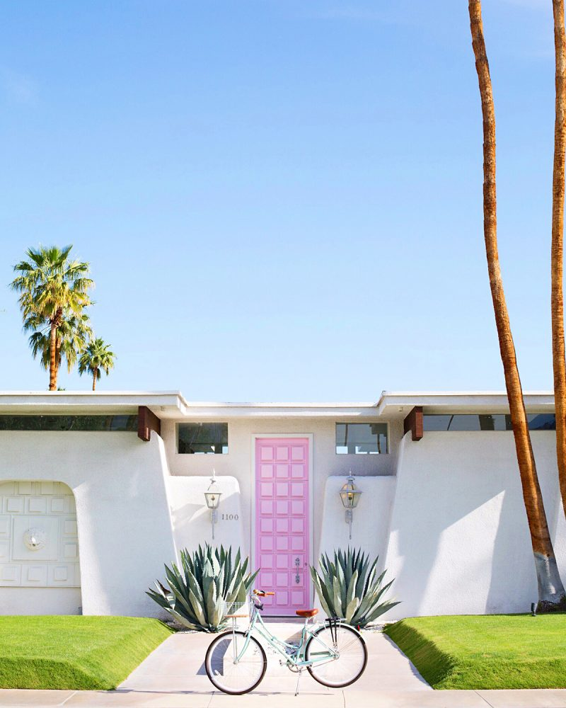 Palm Springs house with pink door and bike