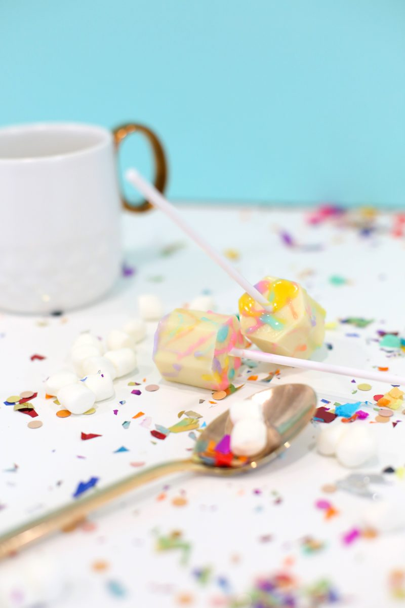 Color Splattered White Hot Chocolate on a Stick