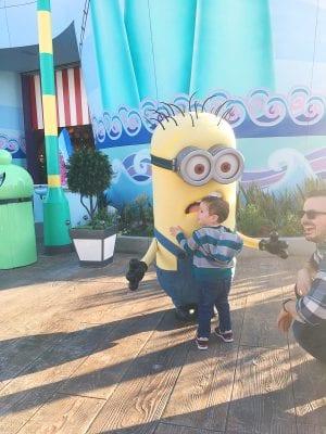Boy hugging a minion