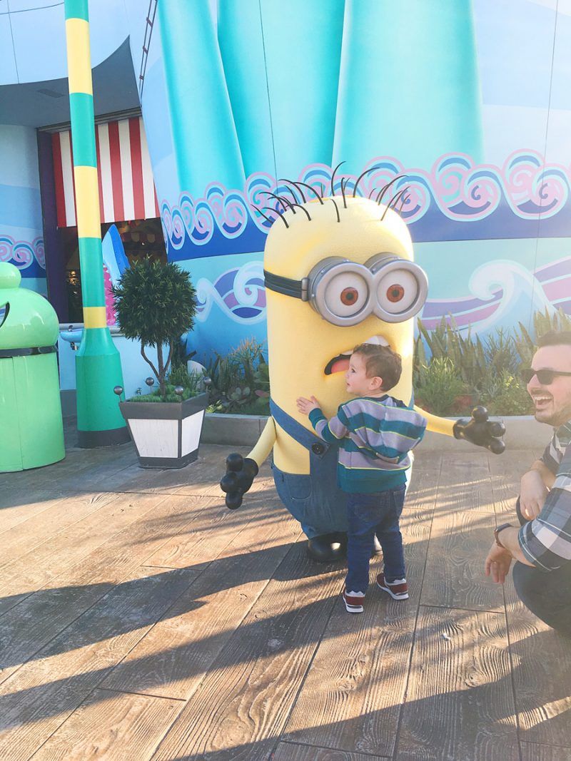 Boy hugging a minion