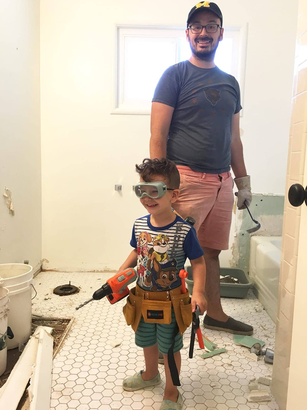 Dad and son bathroom demolition