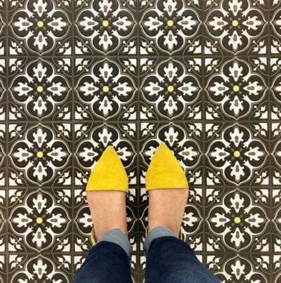 Pattern tile with feet and yellow shoes