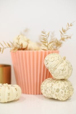 Painted pumpkins with a botanical gold pattern for fall