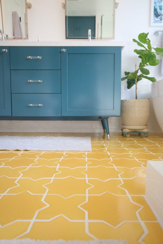 clean yellow tile floor in a master bathroom