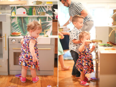 Little girl playing in a toy kitchen