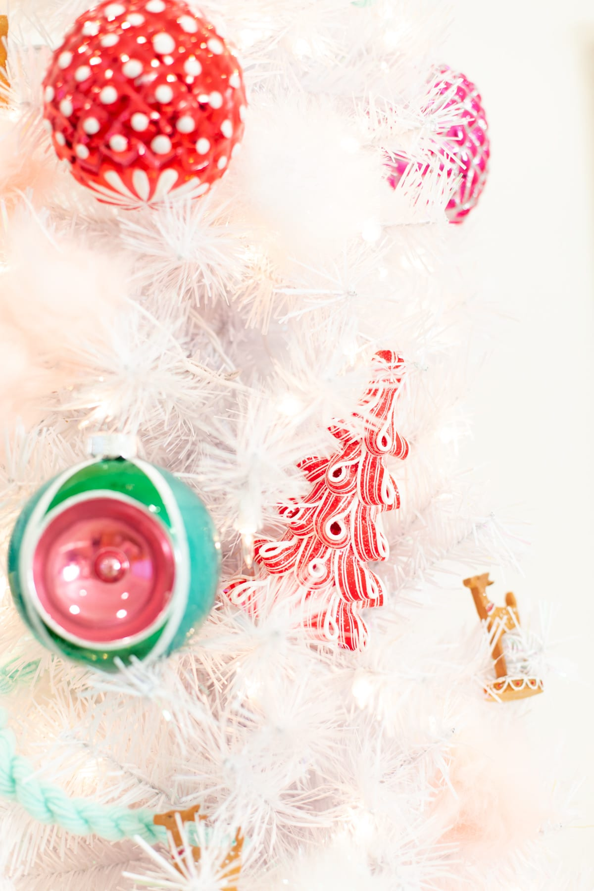 A pink, red, and green Christmas tree
