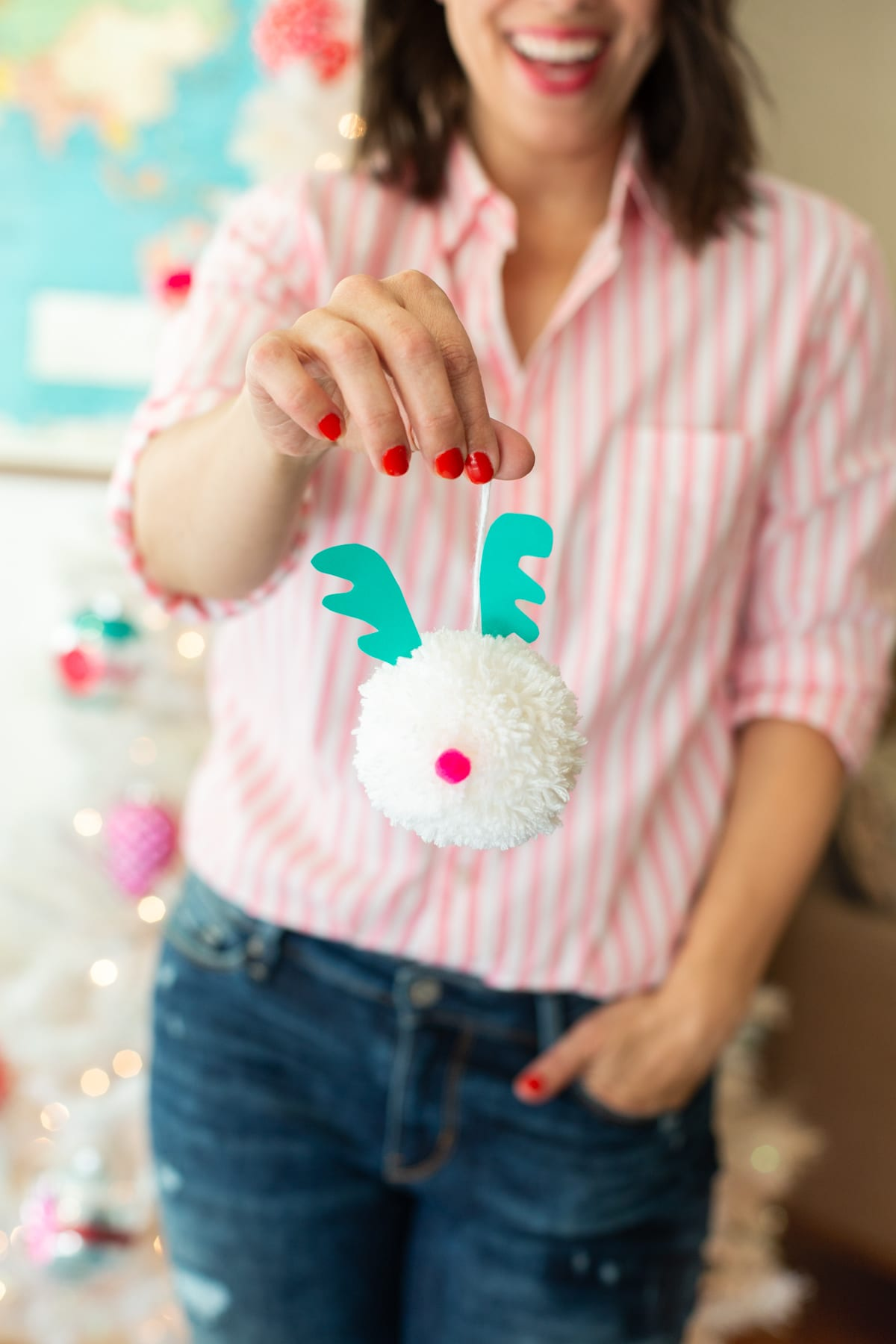 Make pom pom Christmas tree ornaments for a family craft