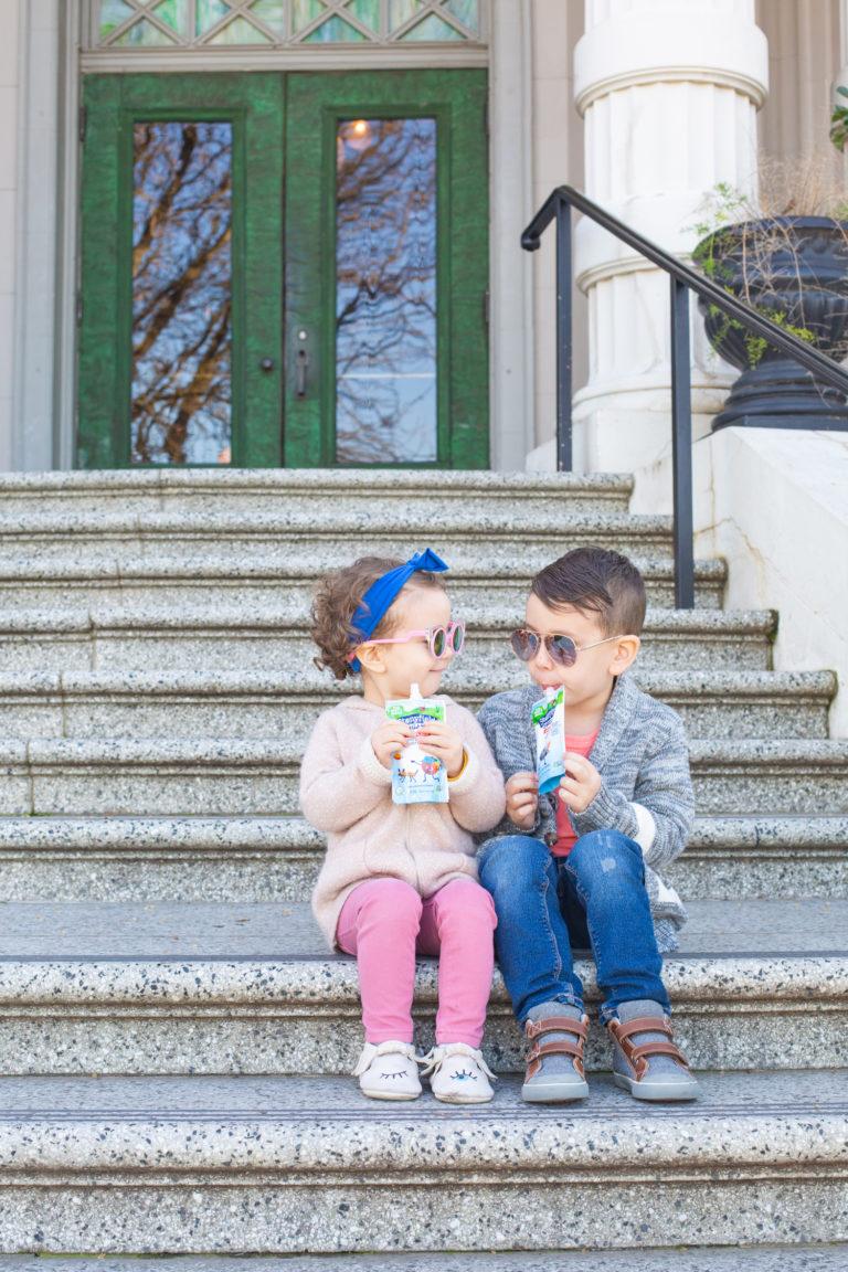 Kids eating yogurt pouches
