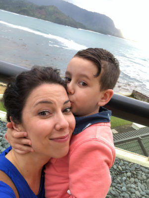 Son and mother hugging on Kauai island