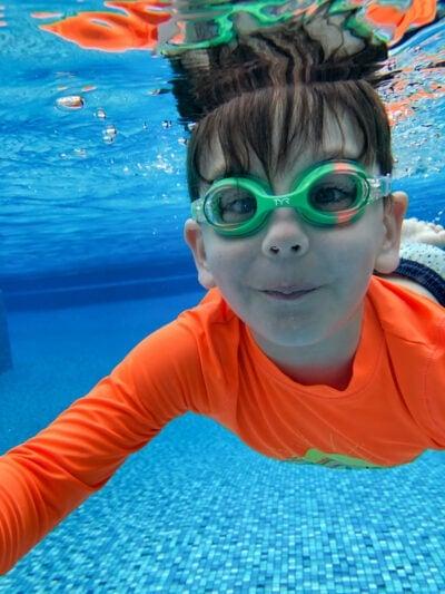 Boy swimming under water in Kauai