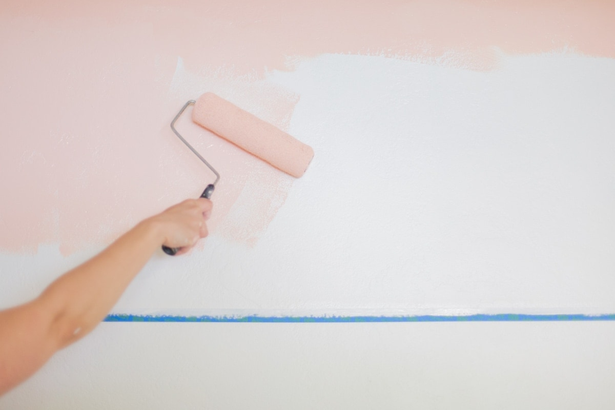 Hand colorblocking pink paint with paint roller