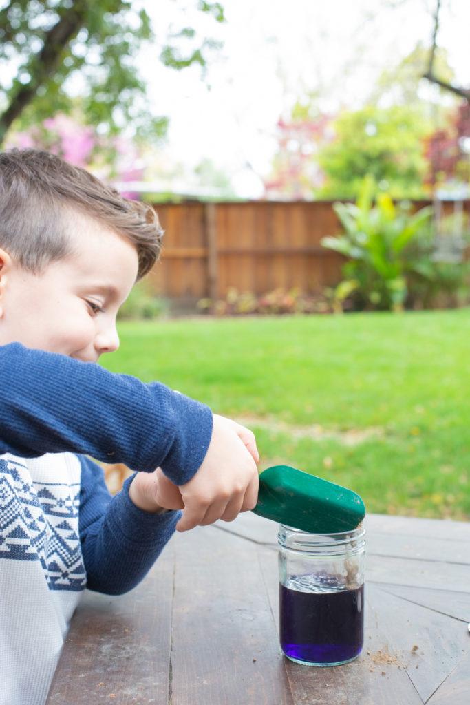 Little boy shoveling soil