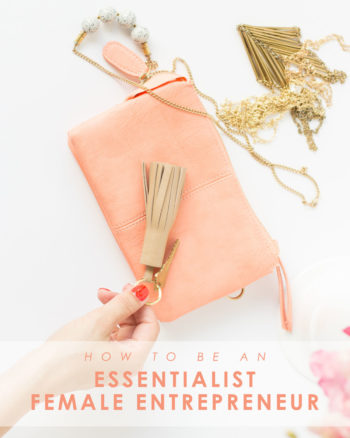 Essentialist female entrepreneur hands grabbing keychain