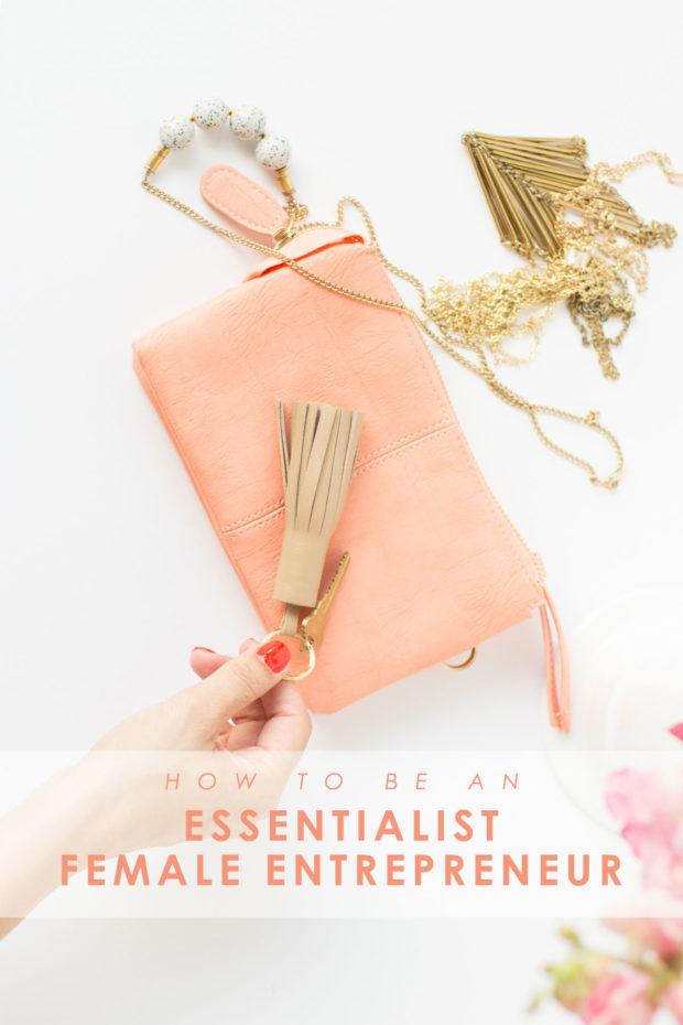 Essentialist female entrepreneur hands grabbing keychain