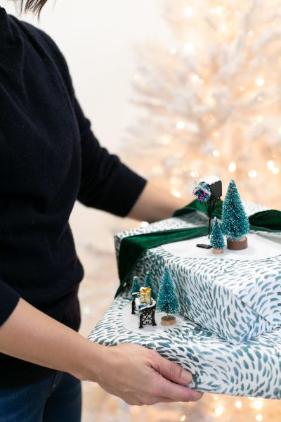 Holiday gift wrapping idea with miniature winter scenes