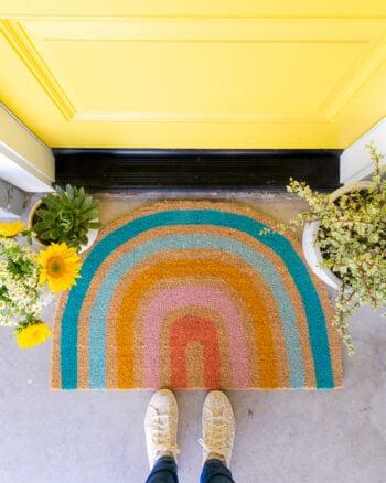 diy rainbow doormat with yellow door