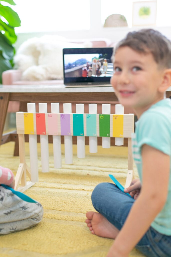 kids playing a diy xylophone