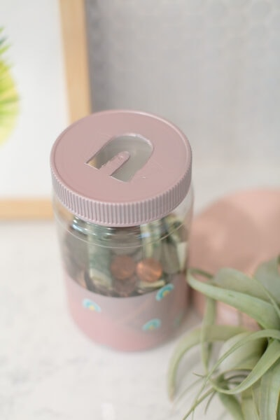 make a piggy bank out of empty jars