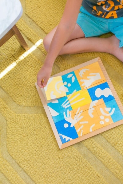 kid doing a wooden puzzle