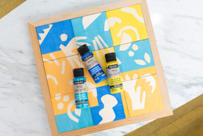 painting a children's wooden puzzle
