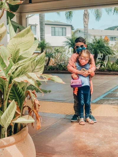 kids hugging in masks