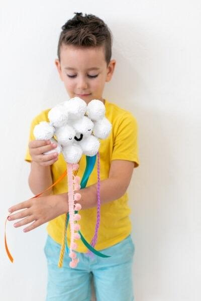 boy playing with egg carton craft