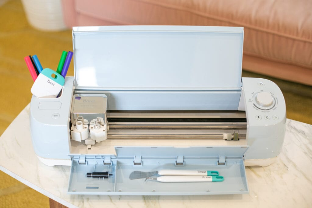 open cricut machine on a table