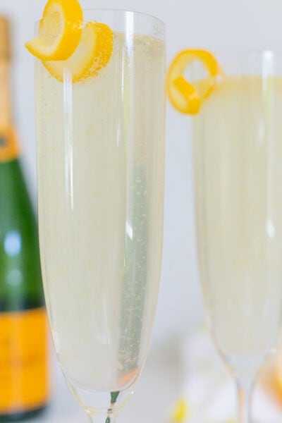 French 75 cocktail close up with lemon twist