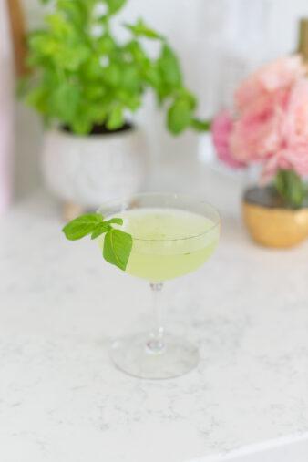 cocktail with basil garnish