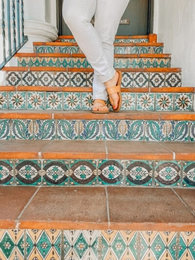 feet on a tile stairdase