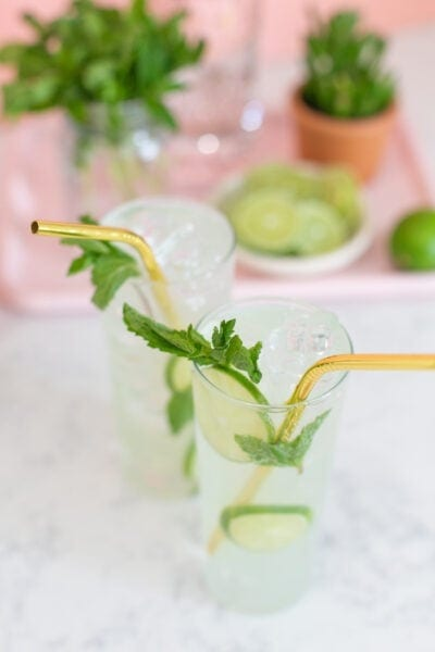 mojito mocktail and cocktail sitting on counter