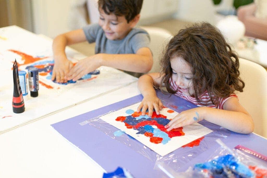 kids making painted crafts