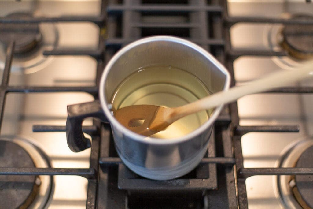 melted beeswax in a double boiler