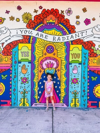 kid in front of san diego mural