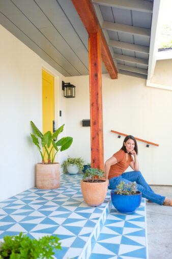 tile front porch with woman sitting